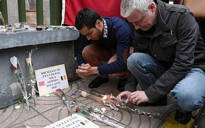 A man lights a candle at a makeshift memorial in tribute to the victims of the Brussels attacks, in Casablanca on March 26, 2016. (Fadel Senna/AFP)