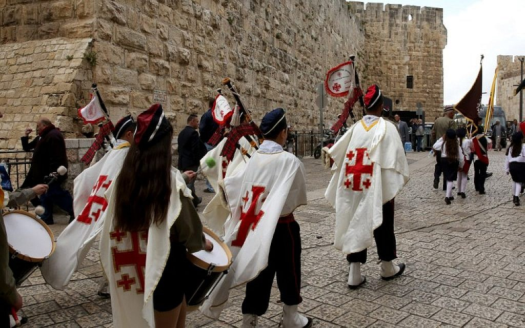 Roman Catholic scouts march during the Easter Sunday procession from the Church of the Holy Sepulchre through Jerusalem''s Old City on March 27, 2016. (AFP / GALI TIBBON)