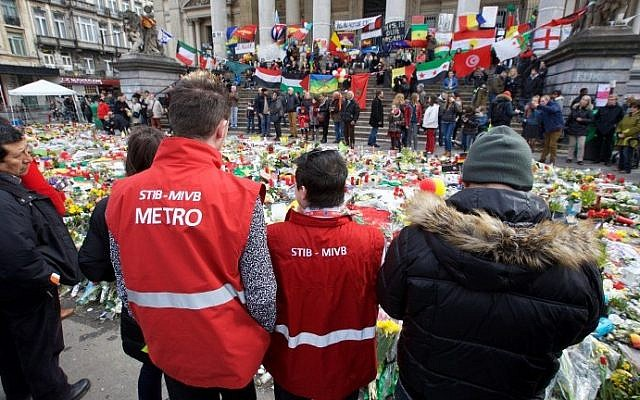 Workers of Brussels' public transport company STIB-MIVB gather to pay a tribute in the square outside the stock exchange in Brussels on March 27, 2016 an area which has become an unofficial shrine to victims of the March 22, terror attacks.  (Nicolas Maeterlinck/Belga/AFP)