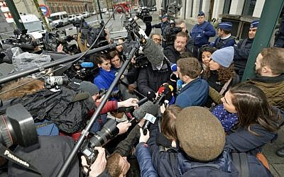 Lawyer Cedric Moisse talks to the press as he leaves the council chamber in Brussels, where two terrorism cases will be heard, on March 31, 2016. (AFP / BELGA AND Belga / Eric LALMAND / Belgium OUT)
