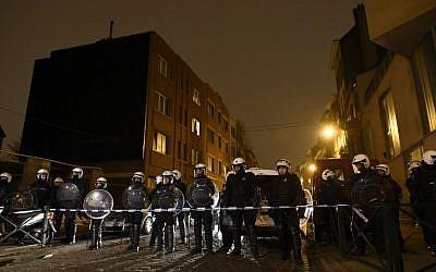 File: Belgian police in the Molenbeek-Saint-Jean district in Brussels, on March 18, 2016. (AFP Photo/John Thys)
