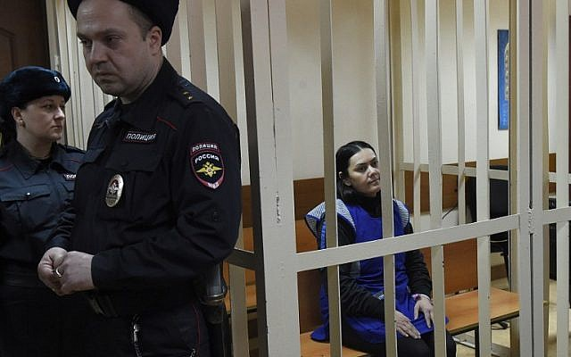 Gyulchekhra Bobokulova, a nanny suspected of killing a young girl in her care, sits inside a defendants' cage during a hearing at a court in Moscow, on March 2, 2016. (AFP/ VASILY MAXIMOV)