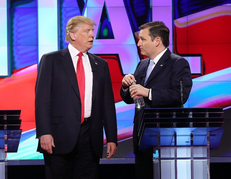 Republican presidential candidates Donald Trump and Sen. Ted Cruz (R-TX), talk during a broadcast break in the CNN, Salem Media Group, The Washington Times Republican Presidential Primary Debate on the campus of the University of Miami on March 10, 2016 in Coral Gables, Florida. (Joe Raedle/Getty Images/AFP)
