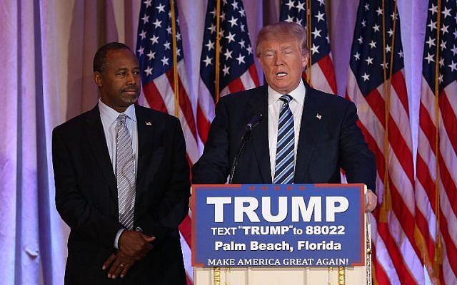 Republican presidential candidate Donald Trump stands with former rival Ben Carson on March 11, 2016. (Joe Raedle/Getty Images/AFP)
