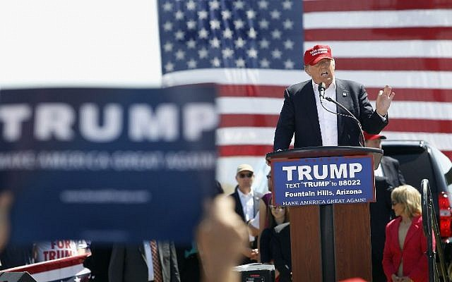 Republican presidential candidate Donald Trump speaks to guests gathered at Fountain Park during a campaign rally in Fountain Hills, Arizona, on March 19, 2016. (Ralph Freso/Getty Images/AFP)