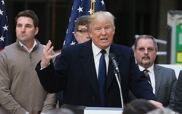 Republican presidential candidate Donald Trump speaks to the media at the Trump International Hotel that is currently under construction March 21, 2016 in Washington, DC. Mark Wilson/Getty Images/AFP)