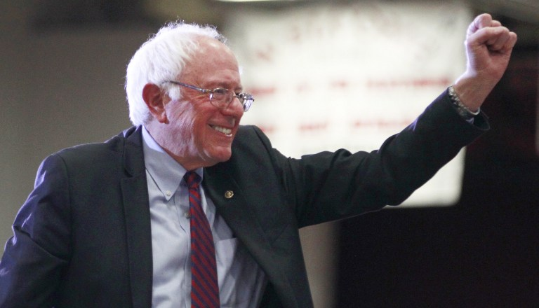 Democratic presidential candidate Bernie Sanders gives a fist pump after his speech at West High School at a campaign rally in Salt Lake City, Utah, March 21, 2016. (George Frey/Getty Images/AFP)