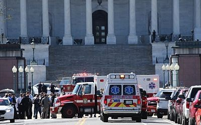 Emergency personnel respond during a lock down after shots were reportedly fired at the US Capitol Visitor Center March 28, 2016 in Washington, DC. (Win McNamee/Getty Images/AFP)