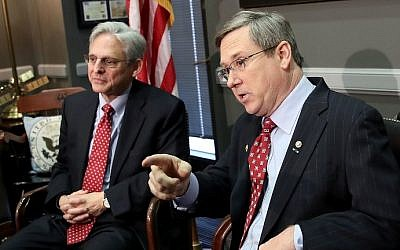US  Sen. Mark Kirk (R-IL) (R) meets with Supreme Court nominee Merrick Garland (L) in Kirk's office on Capitol Hill March 29, 2016 in Washington, DC. (Win McNamee/Getty Images/AFP)