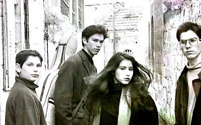Ricka Razel (second from right) and her brothers outside their childhood home in the Nahlaot neighborhood of Jerusalem  (Courtesy Ricka Razel Van-Leeuwen)
