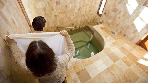 Mikvah immersion is required for Orthodox and Conservative conversions and strongly recommended for Reform conversions. (Mayyim Hayyim/Tom Kates via JTA)