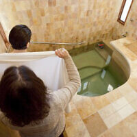 Illustrative: A mikveh immersion for the purpose of conversion to Judaism (Mayyim Hayyim/Tom Kates via JTA)