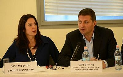 Culture Minister Miri Regev sits next to Macabim-Reut mayor Haim Bibas at a meeting intended to promote culture and sports within the Arab sector, March 10, 2016. (culture ministry)