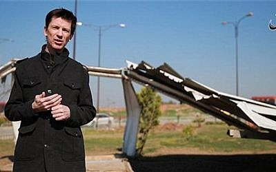 This photo posted online by the Islamic State group-affiliated Amaq News Agency on Friday, March 18, 2016 shows British journalist John Cantlie, who is being held hostage by the militants, during a stand-up for an IS propaganda video in Mosul, Iraq. (militant video, Amaq News Agency via AP)