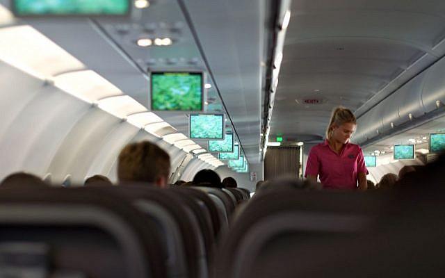 Illustrative photo of an air stewardess on board a flight. (CC BY 2.0 Flikr/Paul Stocker)