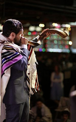 Rabbi Dan Ain, blowing a shofar, is knocking down conventional Judaism's walls and making the profane sacred. (Belathee Photography)