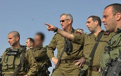 File: Brig.-Gen. Ofek Buchris, second right, motions to then-IDF chief of staff Benny Gantz during a tour in northern Israel, when Buchris was head of the IDF's Bashan Division in 2014. (IDF Spokesperson's Unit)