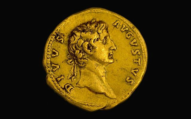 A 2,000-year-old coin featuring a portrait of the emperor 'Deified Augustus.' (Samuel Magal, courtesy of the Israel Antiquities Authority)