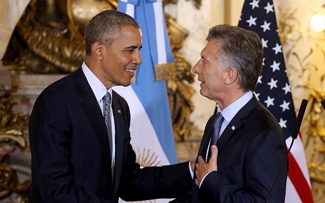 US President Barack Obama shakes hands with Argentina's President Mauricio Macri at the government house in Buenos Aires, Argentina, Wednesday, March 23, 2016. Obama is on a two day official visit to Argentina. (Martin Zabala/Pool Photo via AP)