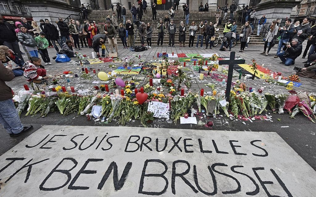 A banner for the victims of the bombings reads 'I am Brussels' at the Place de la Bourse in the center of Brussels, Wednesday, March 23, 2016 (AP Photo/Martin Meissner)