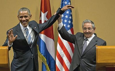 Cuban President Raul Castro, right, lifts up the arm of US President Barack Obama at the conclusion of their joint news conference at the Palace of the Revolution, Havana, Cuba, March 21, 2016. (AP/Ramon Espinosa)