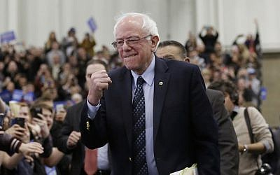 Democratic presidential candidate, Sen. Bernie Sanders, I-Vt, pumps his fist as he arrives for at a rally at the Macomb Community College, Saturday, March 5, 2016, in Warren, Mich. (AP Photo/Carlos Osorio)