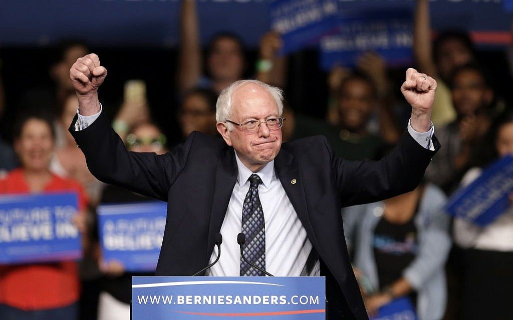 Democratic presidential candidate, Sen. Bernie Sanders (I-VT) acknowledges his supporters on arrival at a campaign rally, Tuesday, March 8, 2016, in Miami. (AP Photo/Alan Diaz)