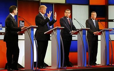 Republican presidential candidate Donald Trump, second from left, gestures as Sen. Marco Rubio, R-Florida, Sen. Ted Cruz, R-Texas, and Ohio Gov. John Kasich watch him in the Republican presidential primary debate at Fox Theatre in Detroit, Michigan, Thursday, March 3, 2016. (AP Photo/Paul Sancya)