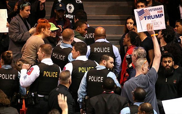A demonstrator is removed by Chicago police during a rally for Republican presidential candidate Donald Trump at the University of Illinois at Chicago Pavilion in Chicago on Friday, March 11, 2016. (Chris Sweda/Chicago Tribune via AP)