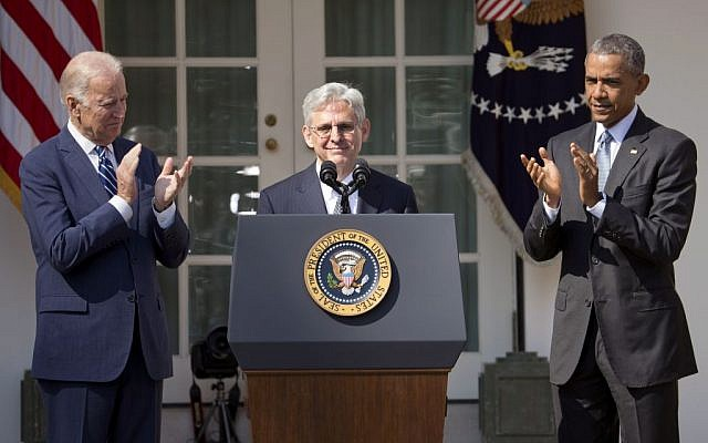 Federal appeals court judge Merrick Garland receives applauds from President Barack Obama and Vice President Joe Biden as he is introduced as Obama's nominee for the Supreme Court during an announcement in the Rose Garden of the White House, in Washington, Wednesday, March 16, 2016. (AP/Pablo Martinez Monsivais)