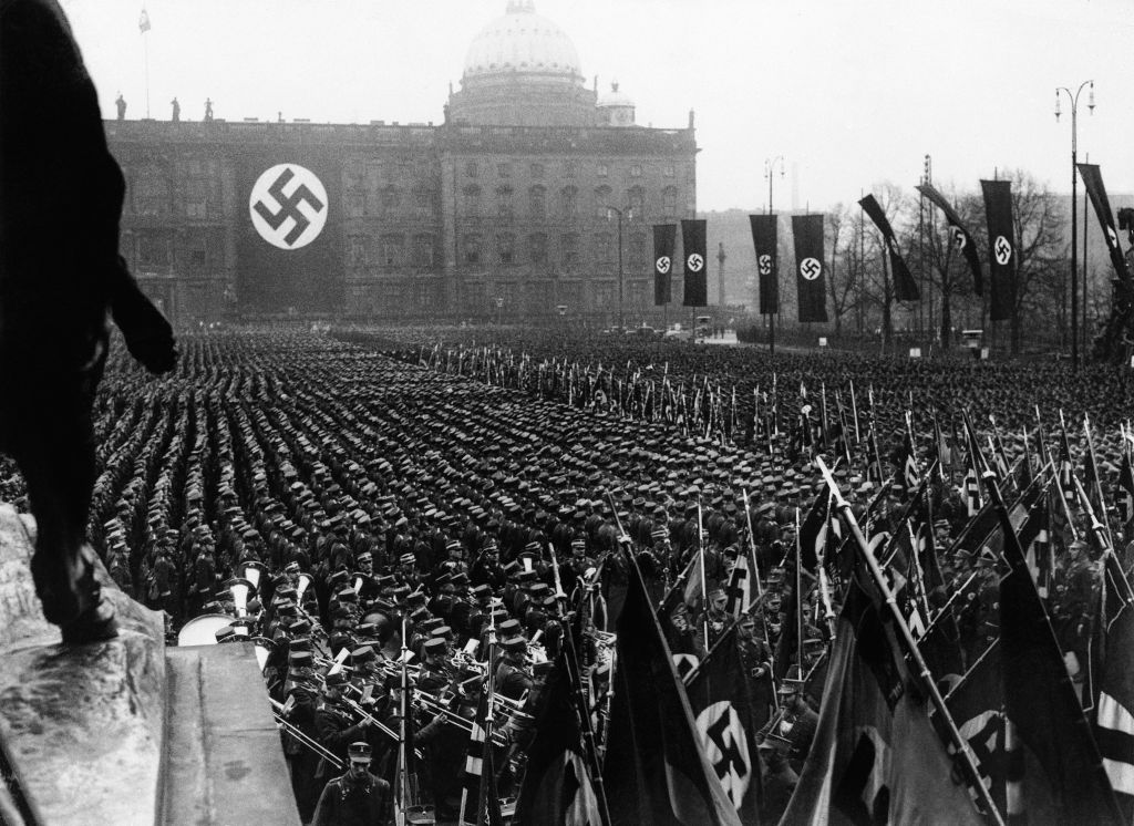 The Associated Press photographs the third anniversary of National Socialism's accession to power in 1933 widely celebrated throughout Germany on Feb. 11, 1936. At noon, Adolf Hitler assembled 25,000 of his oldest stormtroop comrades in the Lustgarten in Berlin. In his address, Hitler reiterated Germany's will to peace. This is a general view of the banner and flag bearers in Berlin. (AP Photo)