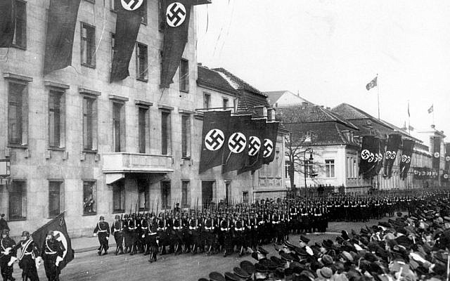 A parade of Nazi black guards marching past the Reich Chancellory on Wilhelmstrasse during their parade in Berlin, Germany, on Jan. 30, 1937. (AP)