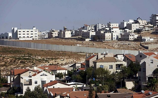 The town of Anata, with the Jerusalem neighborhood of Pisgat Zeev in the foreground. ( Mohamar Awad/Flash 90)