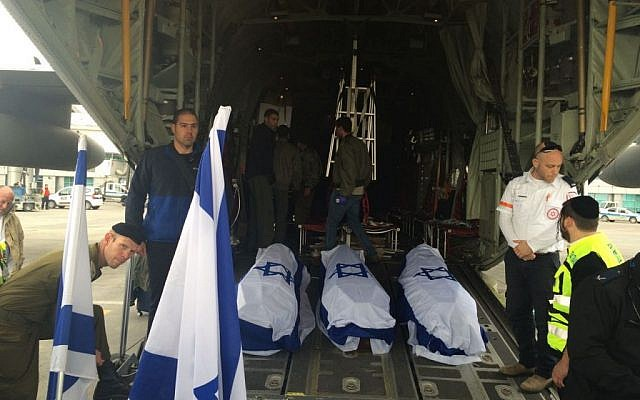 The bodies of three Israelis killed in a suicide bombing in Istanbul lie in caskets on the cargo ramp of an IDF airplane on Sunday, March 20, 2016 (Foreign Ministry)