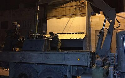 Soldiers load gunsmithing equipment onto a truck in Nablus on March 1, 2016. (Shin Bet)
