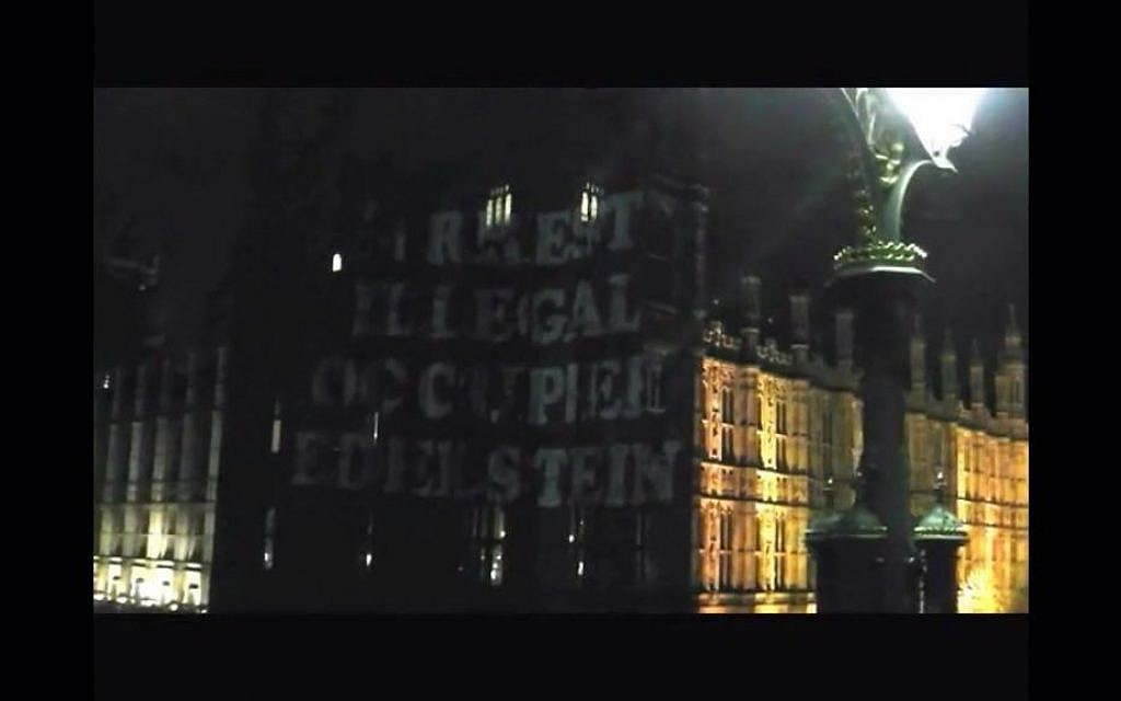 """Arrest illegal occupation Edelstein,"" projected onto the walls of the Palace of Westminster, March 2, 2016. (Screenshot from YouTube)"