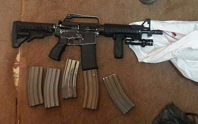 A rifle and ammunition confiscated by Israeli security forces in Nablus on March 1, 2016. (Shin Bet)