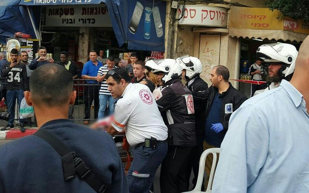 Medics evacuate the victim of  a stabbing attack in Petah Tikva on March 8, 2016. (Magen David Adom)