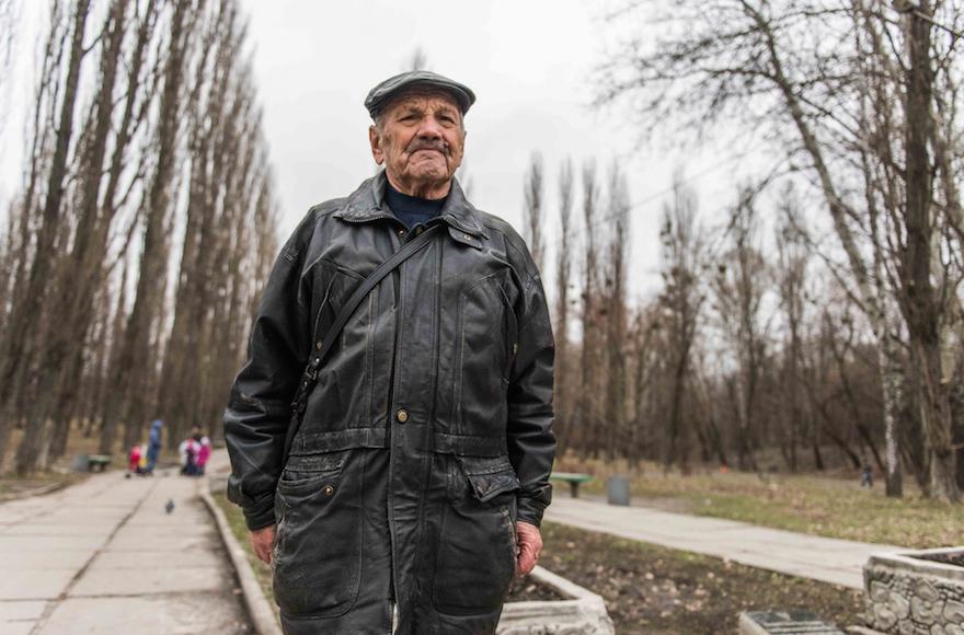 Vladimir Proch, a Ukrainian Jew, standing near Kiev's Babi Yar monument, March 14, 2016. (Cnaan Liphshiz/JTA)