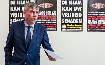 """Far right Flemish Interest leader Filip Dewinter addresses the media on his party's proposals to fight terrorism, at the Belgian federal parliament in Brussels, Tuesday, March 29, 2016. The posters on the back read in Dutch: """"Islam can harm your freedom"""". (AP Photo/Geert Vanden Wijngaert)"""