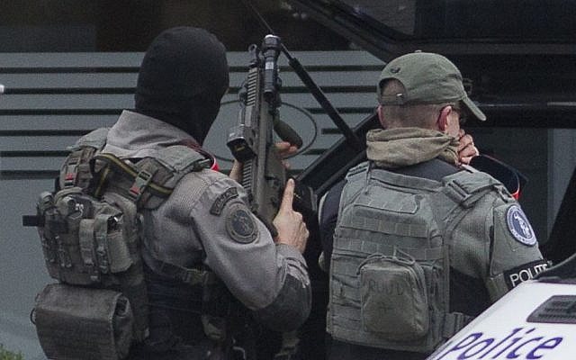 Police secure the Forest neighborhood in Brussels after an apartment raid during a major anti-terror operation, March 15, 2016. (AP Photo/Thierry Monasse)