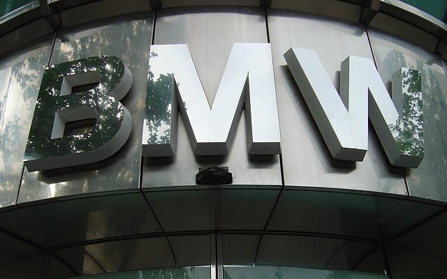 A BMW logo over a Berlin showroom (CC BY Mangan 2002, Wikimedia Commons)