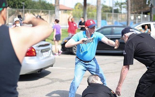 Brian Levin intervening in a confrontation with Ku Klux Klan members in Anaheim, California, March 1, 2016. (Heather Boucher/Davini Photo)