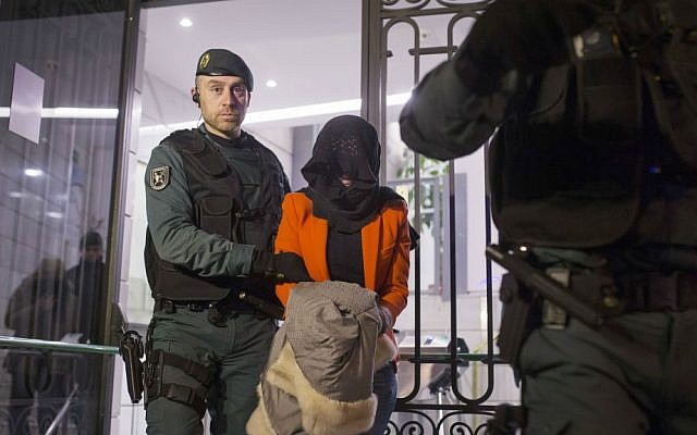 Illustrative photo of a Spanish Civil Guard policeman detaining a suspect in Madrid, Spain. February 17, 2016 (AP Photo/Francisco Seco, File)