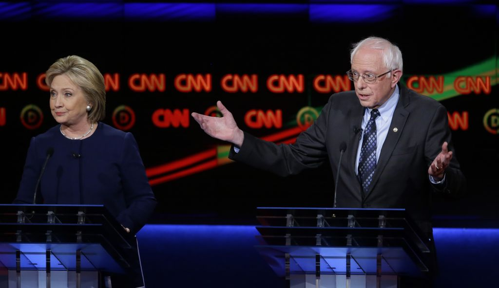 Democratic presidential candidate, Sen. Bernie Sanders, I-Vt., argues a point as Hillary Clinton looks on during a Democratic presidential primary debate at the University of Michigan-Flint, Sunday, March 6, 2016, in Flint, Mich. (AP Photo/Carlos Osorio)