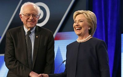 Democratic presidential candidates Sen. Bernie Sanders and Hillary Clinton shake hands before the start of a presidential debate in Miami, Florida, on March 9, 2016. (AP/Wilfredo Lee)