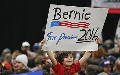 A child holds a sign supporting Democratic presidential candidate Sen. Bernie Sanders while awaiting his arrival at the San Diego Convention Center Tuesday, March 22, 2016. (AP/Lenny Ignelzi)