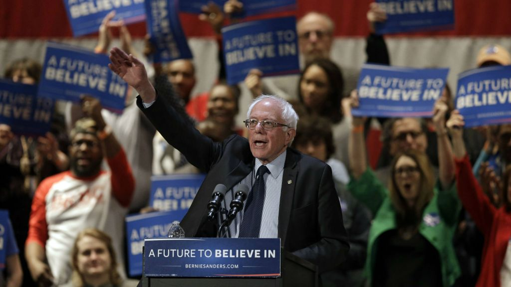 Democratic presidential candidate Sen. Bernie Sanders, I-Vermont, waves after speaking at a campaign rally at the Akron Civic Theatre in Akron, Ohio, Monday, March 14, 2016. (AP Photo/Tony Dejak)