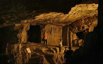 Visitors explore Zedekiah's Cave, also known as Solomon's Quarries, an underground limestone quarry that runs the length of five city blocks under the Muslim Quarter of the Old City of Jerusalem on August 21, 2008. (Michal Fattal /FLASH90)