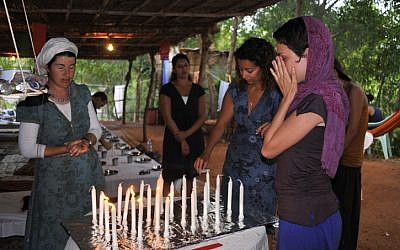 Israeli backpackers light shabbat candles in India on January 20, 2010. (Serge Attal / Flash90)